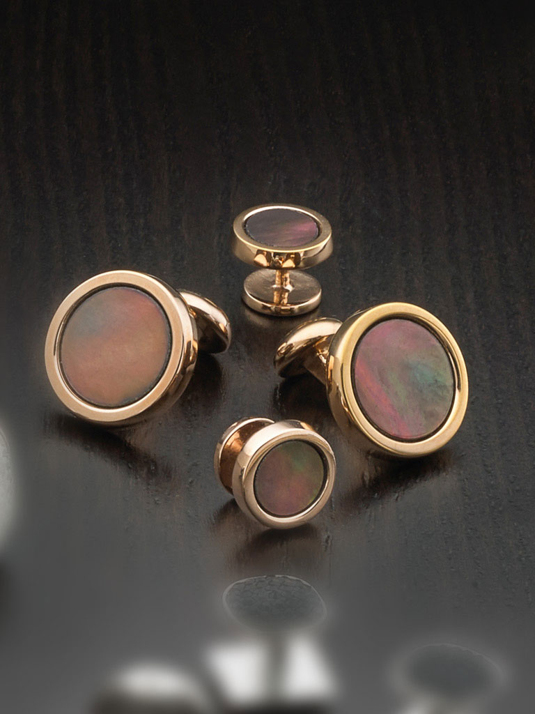 Rose gold over sterling silver and mother of pearl center with button backing